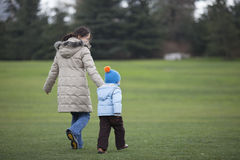Chinese mother and son walking on the grass land Stock Image