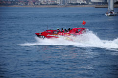 Chinese motorboat Qingdao China. A speedboat with Chinese tourists on the waters of Fushan Bay in the city of Qingdao China in a sunny day in Shandong province royalty free stock photography