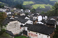 Chinese mountain village with rapeseed flower blossom Royalty Free Stock Photography