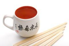 Chinese mug with hieroglyphs. Over white background stock photos