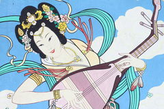 Chinese mural. Chinese girl play the music, Chinese mural Royalty Free Stock Photography