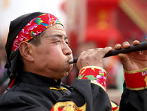 The trumpet player. Chinese Musical Instruments - the suona performer, similar to the trumpet, holiday music free on the streets in the show Stock Image