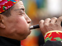 The trumpet player. Chinese Musical Instruments - the suona performer, similar to the trumpet, holiday music free on the streets in the show Royalty Free Stock Image