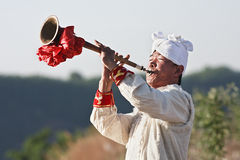 Chinese musician plays a trumpet. YAN'AN-CHINA-MAY 25, 2009. Local musician plays a trumpet on May 25, 2009 in Yan'an. It has 1,400 years history and was for Royalty Free Stock Image