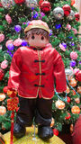 Chinese national custome. A doll dressed in Chinese national custome with the Christmas tree and Christmas balls in the background.  Photo taken on November 14th Stock Images