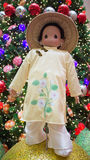 Chinese national custome. A doll dressed in Chinese national custome with the Christmas tree and Christmas balls in the background.  Photo taken on November 14th Royalty Free Stock Photo