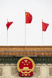 Chinese national emblem and flag Royalty Free Stock Image