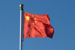 Chinese national flag. Flying in the blue sky stock images