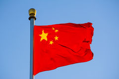 Chinese national flag aflutter in the wind Stock Photos