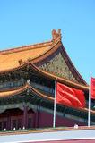 Chinese national flag waving in the main entrance in Forbidden city Beijing, China Royalty Free Stock Image