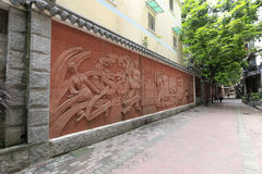 Chinese national historical relief at guantajie alley Stock Photo