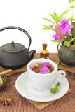 Chinese natural medicine with a cup of tea and anise. Chinese natural medicine with a cup of tea, flower petals and star anise Royalty Free Stock Photos