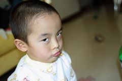A Chinese naughty baby staring Royalty Free Stock Image