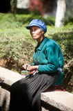 Chinese Naxi old woman is knitting. Stock Photo