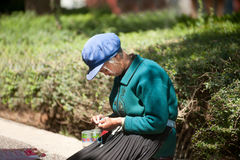 Chinese Naxi old woman is knitting. Stock Photography