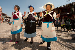Chinese Naxi old woman performing a dance. Stock Photography