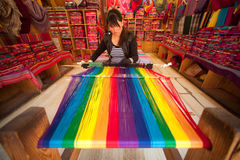 Chinese Naxi woman weaving shown to tourists in Lijiang . Stock Photography