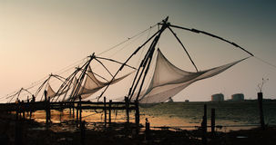 Chinese nets. At sunset, Kochi, Kerala, India royalty free stock photography