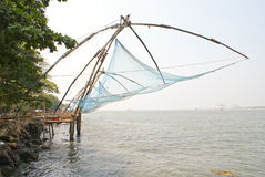 Chinese nets along the sea coast. A number of Chinese nets ready for fishing installed along the sea coast in Kochi,India Stock Photo
