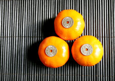 Chinese New Year. Three mandarin oranges and coins for Chinese New Year
