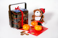Chinese New Year. Three mandarin oranges, envelopes, gift box and coins for Chinese New Year Stock Photography