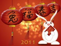 Chinese New Year 2011 Rabbit Red Money Packet. Happy Chinese New Year 2011 Rabbit Holding Red Money Packet Illustration Stock Photo