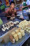 Chinese New Year 2012 - Bangkok , Thailand. BANGKOK - JANUARY 23 : Chinese New Year 2012 - Selling Fried Bananas in Chinatown, Bangkok, Thailand Royalty Free Stock Photography