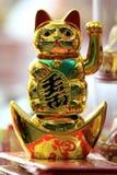 Chinese New Year 2012 - Bangkok , Thailand. BANGKOK - JANUARY 23 : Chinese New Year 2012 - Waving Gold Cat in Chinatown, Bangkok, Thailand Royalty Free Stock Photo