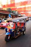 Chinese New Year 2012 - Bangkok , Thailand. BANGKOK - JANUARY 23 : Chinese New Year 2012 - Tuk tuk\'s go past in Chinatown, Bangkok, Thailand Stock Photo