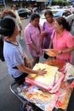 Chinese New Year 2012 - Bangkok , Thailand. BANGKOK - JANUARY 23 : Chinese New Year 2012 - Woman sells gold decorations in Chinatown, Bangkok, Thailand Stock Images