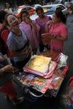 Chinese New Year 2012 - Bangkok , Thailand. BANGKOK - JANUARY 23 : Chinese New Year 2012 - Woman sells gold decorations in Chinatown, Bangkok, Thailand Royalty Free Stock Photography
