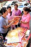 Chinese New Year 2012 - Bangkok , Thailand. BANGKOK - JANUARY 23 : Chinese New Year 2012 - Woman sells gold decorations in Chinatown, Bangkok, Thailand Royalty Free Stock Photo