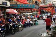 Chinese New Year 2012 - Bangkok , Thailand. BANGKOK - JANUARY 23 : Chinese New Year 2012 - People walking through the busy streets in Chinatown, Bangkok Stock Images
