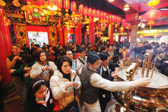 Chinese New Year. Devotees at  Temple burn incense for good luck in the coming year. Photo took in Taiwan Stock Photos