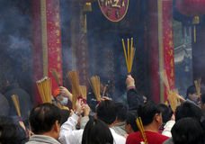 Chinese New Year. People praying for good fortune at Wong Tai Sin Temple in Hong Kong stock photo