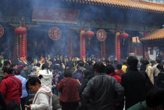 Chinese New Year. People praying for good fortune at Wong Tai Sin Temple in Hong Kong stock photos