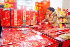 Chinese New Year is approaching, people are buying festive decorations Stock Image