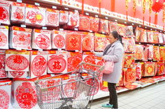 Chinese New Year is approaching, people are buying festive decorations Royalty Free Stock Photography