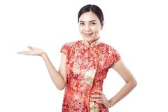 Chinese new year Asian girl. Asian girl greeting in traditional Chinese new year Royalty Free Stock Photography