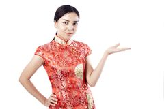 Chinese new year Asian girl. Asian girl greeting in traditional Chinese new year Royalty Free Stock Photo