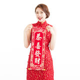 Chinese new year. asian woman showing the red couplets Stock Photography