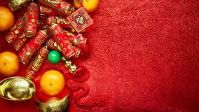 Chinese new year background. Chinese coins luck and firecrackers or chinese knot and Chinese gold ingots and Traditional Foreign text means lucky blessing and Royalty Free Stock Photos