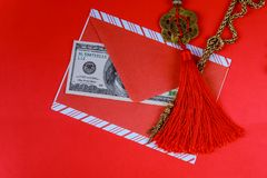 Chinese New Year background. US dollars Chinese good luck symbol on red. Chinese New Year background. Chinese good US dollars luck symbol isolated on red stock image