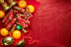 Chinese new year background. Chinese coins luck and firecrackers or chinese knot and Chinese gold ingots and Traditional Foreign text means lucky blessing and Royalty Free Stock Image