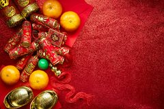 Chinese new year background. Chinese coins luck and firecrackers or chinese knot and Chinese gold ingots and Traditional Foreign text means lucky blessing and Royalty Free Stock Photography