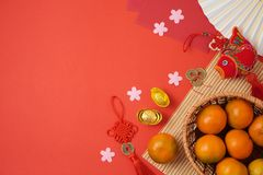 Chinese New Year background with traditional decorations for Spring festival on red table royalty free stock photo