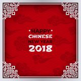 Chinese New Year 2018 banner. White tracery ornate frame with congratulation text on red pattern background with oriental clouds Royalty Free Stock Photography