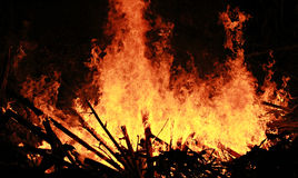 Chinese New Year Bonfire, Chiang Khong, Thailand. Bonfire slowly burns at night on the banks of the Mekong for Chinese New Year in Chiang Khong, Thailand Stock Images