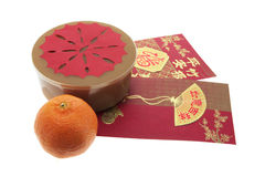 Chinese New Year Cake and Red Envelopes Stock Image