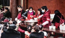 Chinese New Year Celebration. Chengdu, China - 05 February 2019: Volunteers handing out free food at Chinese New Year royalty free stock photography
